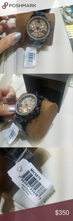 Nwt Michael kors gunmetal watch MK5879 Brand new with tags. Gunmetal watch with orange/pink rhinestones. Sorry no trades. Retails for 375 plus tax. Will come with a Michael kors box. Michael Kors Accessories Watches