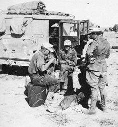 Afrika Korp soldiers relax next to their Kfz 70 Horch 1500A while serving in North Africa