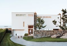 """When this minimalist, L-shaped modern structure was first erected on the Massachusetts coastline, neighbors said it """"looked like the ladies' wing at Alcatraz,"""" according to the original resident, John Hagerty. Decades later, guests are still stopping by to explore this inspired Walter Gropius/Marcel Breuer collaboration. #dwell #moderndesign #modernarchitecture"""