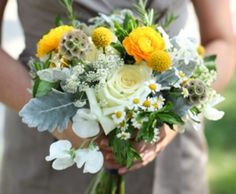 Pretty.  White and yellows with sweet peas, dusty miller and scabiosa pods