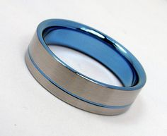 A more colorful version of my original pinstripe rings. Interior: polished titanium anodized sky blue  Exterior: satin finished titanium with a sky