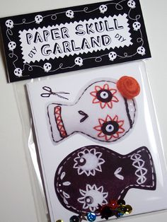DIY Halloween Paper Skull Garland, black and white