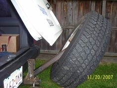 Tire spare carrier swinging excursion ford