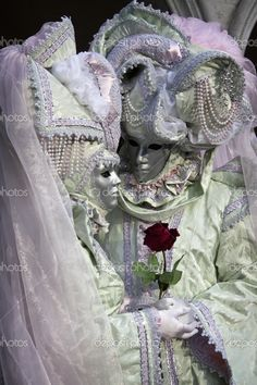 95c6913775f A couple in white and pastel costumes Venetian Carnival Masks