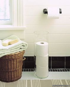 Roll Holder - Stow spare rolls of toilet paper in a clear glass vase or umbrella stand; it's a sleek way of stacking them, and you'll know at a glance when you need to refill the supply.