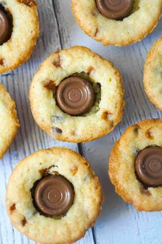 Rolo Sugar Cookie Cups are an easy dessert recipe using Betty Crocker Sugar Cookie Mix. These delicious cookies are baked in mini muffin tins and loaded with Skor bits, mini chocolate chips and Rolo chocolates.