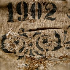 The burlap, its ageing/distressing, the stencilled old-fashiony numbers...