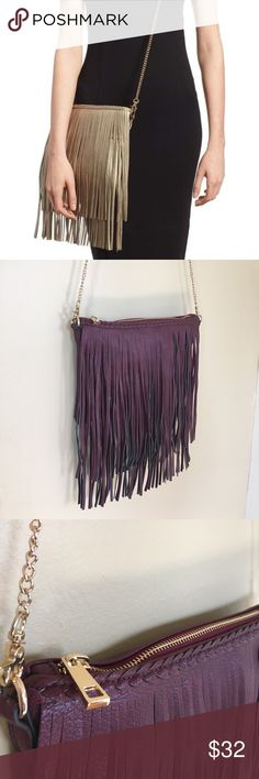 "STREET LEVEL Fringe Crossbody Bag Very lightly used. Like new, in and out! Purchased from Nordstrom.   Long fringe and cool braided trim define a trend-right bag that can be worn as a crossbody or used as a clutch.  Bag section measure approx 11"" wide by 7.5"" deep.  Top zip closure. Optional, gold tone chain crossbody strap. Interior wall and smartphone pockets. Polyurethane.  Bag comes in burgundy color only. Street Level Bags Crossbody Bags"