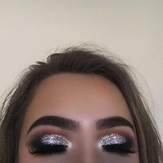 Gorgeous Silver Eye Makeup Looks You Need to Try Loading. Gorgeous Silver Eye Makeup Looks You Need to Try Silver Glitter Eye Makeup, Black Eye Makeup, Dramatic Eye Makeup, Formal Makeup, Smokey Eye Makeup, Eyeshadow Makeup, Glitter Lips, Prom Makeup For Brown Eyes, Smokey Eye With Glitter