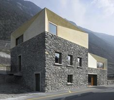 Geneva studio clavienrossier created this home in the Swiss Alps by adding two tinted concrete volumes atop the remains of a stone house and...