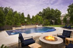 Midnight Blue - mediterranean - pool - dallas - Pool Environments, Inc.    Match pavers under covered lanai with stone around fire pit  and stone border coping on pool - the rest can be concrete decking.