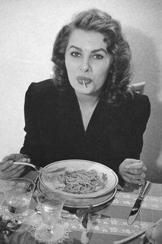 Sophia Loren eating spaghetti in a restaurant in Italy, 1953. Photo by Franco Fedeli