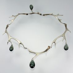 "A sterling silver full antler necklace with four faceted moss aquamarines. Total length is 16""."