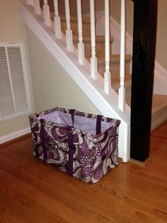 Stair Clutter: I bought a Large Utility Tote and put Next Level on it to ensure that everyone knows it should remain by the stairs. All the items that use to gather on the stairs are now placed in the bag to carry upstairs. It makes it easier to carry the items into each room to return them to their proper home.    Thirty-One Large Utility Tote in Patchwork Paisley