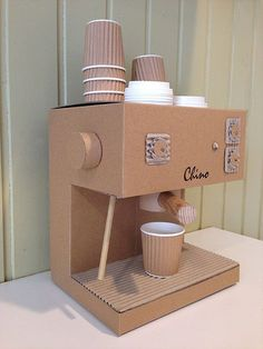 Handmade Toy Cappuccino Machine made out of Cardboard with 8 Baby Chino Cups with Lids and a metal Froth Jug. Cardboard Kitchen, Cardboard Box Crafts, Cardboard Sculpture, Cardboard Crafts, Cardboard Playhouse, Cardboard Furniture, Cardboard Costume, Diy Karton, Decoration Christmas