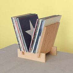 Solid douglas Fir LP record stand. Displays 35 records and optimizes browsing. Sides and base slotted together and ships flat.