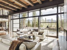 Interior Design: Alluring Modern Rustic Decor Living Room Featuring Exposed Wooden Beams And Light Grey Fabric Upholstered Seating With Brown Fur Throw And Large Black Steel Framed Picture Window - The Coolest Ideas for Rustic Modern Living Room Modern Mountain Home, Mountain Living, Modern Rustic Decor, Rustic Design, Modern Design, Modern Boho, Home Living, Living Rooms, Living Area