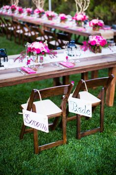 Bride and Groom Signs on Wooden Chairs | photography by http://acquaphoto.com