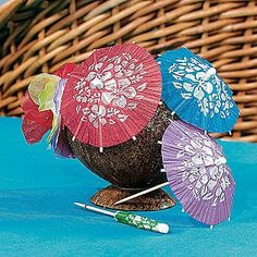 """Box of 144 Cocktail Drink Hawaiian Paper Parasol Umbrella Picks by Oriental Trading Co. $5.68. Great Accent for your Luau Party. 144~3.5"""" Paper Umbrellas on 4"""" Wooden Picks. Paper Hibiscus Cocktail Parasols. Assorted colors. (1 gr./DB) 2"""" parasol on a 4"""" stick. Accessories not included."""