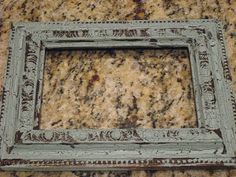How to make a crackle-paint frame.  Love this idea!  I think it would look cool in colors other than blue, although I love how this color makes the frame look like old, oxidized bronze.