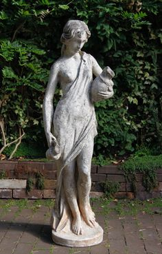 Lady with jugs! Garden ornament.