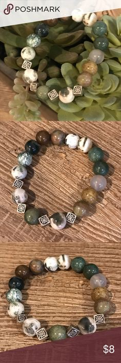 this handmade stretch bracelet feature glossy jasper beads in earthen green tones combined with four silver plated celtic knots a more traditional way to