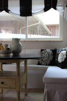 Kitchen banquette- the skirt is cool to cover the bottom piece...