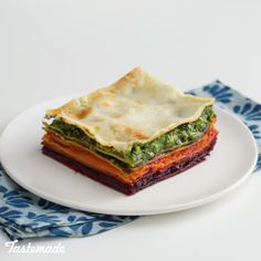 Eating the rainbow is made easy with this multi-veggie lasagna made with beets, carrots, spinach and basil pesto. #baking #pasta #lasagna #easylasagna #healthy