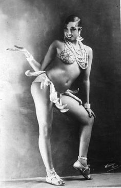 Josephine Baker was a hit in Paris cabarets, singing, dancing, and goofing around. In the 1930s, she was the most successful American entertainer in Paris. She got rich fast and was a superstar. She is wearing her notorious silly but erotic banana skirt. ca. 1925