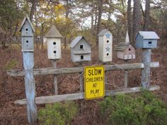 RC made bird houses  on a wooden fence post