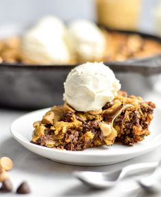 This Healthy Skillet Peanut Butter Oatmeal Cookie is a chocolate and peanut butter lover's dream come true. A slightly under-baked, gooey dessert bursting with peanut butter and chocolate and given a healthy makeover! Gluten-free, dairy-free and refined sugar free!