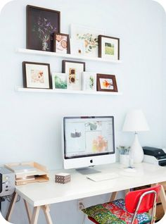 Frames on wall shelves