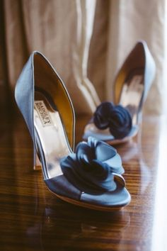Navy and floral Badgley Mischkas: http://www.stylemepretty.com/little-black-book-blog/2012/12/03/maryland-wedding-from-sam-hurd-photography-roberts-co-events/ | Photography: Sam Hurd - https://www.samhurdphotography.com/
