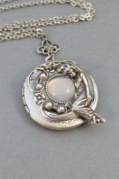 Moonbeam Locket necklace, Made with a vintage moonstone surrounded by a MoonGoddess! Shop the link in my bio! Cute Jewelry, Silver Jewelry, Jewelry Accessories, Unique Jewelry, Jewelry Necklaces, Silver Rings, Jewellery, Moonstone Necklace, Locket Necklace
