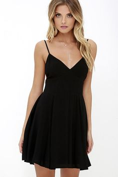 We call 'em like we see 'em, and the From the Heart Black Skater Dress is worthy of a shout out or two! This classic LBD made from lightweight rayon has adjustable spaghetti straps, a set-in waist (with smocking at back) and full skater skirt.
