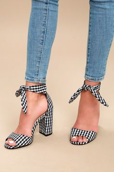 The Covington Black and White Gingham Ankle Strap Heels are this season's must-have heel! Adorable, black and white gingham fabric shapes a curved toe strap, while matching ankle straps tie atop the structured heel cup.