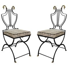 A Hollywood Regency Pair of Lyre Back Black Wrought Iron Arm Chairs With Swan