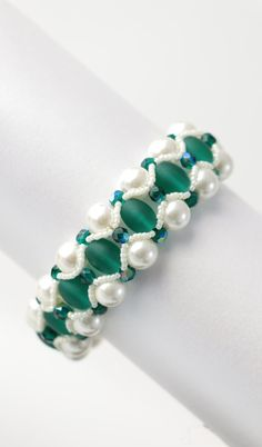 Check out this item in my Etsy shop https://www.etsy.com/uk/listing/491203401/frosted-emerald-and-ivory-pearl-bracelet