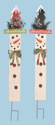 Fence picket snowmen. They need cute faces
