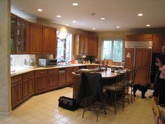 Rustic Craftsman Cherry Kitchen with Contrasting Espresso Island in Bel Air, MD. Refacing Kitchen Cabinets, Before After Kitchen, Kitchen Renovation, Cabinet, New Kitchen, Kitchen, Custom Kitchen Cabinets, Refacing Kitchen Cabinets Cost, Cabinet Refacing