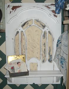 DIY Craft Projects using Old Ceiling tin tiles - Trash to Treasure - the front of an old radio with a tin tile behind it.