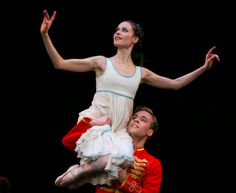 Emma Maguire as Clara with Alexander Campbell as Hans Peter (The Nutcracker) in Act 1 of the Royal Ballet's The Nutcracker. Photo by Alice Pennefather