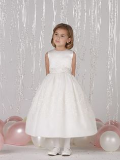 Joan Calabrese for Mon Cheri 212368 Sleeveless satin and organza tea-length full A-line dress with jewel neckline, satin bodice features waistband with three-dimensional lace motif, satin tie-back sash, organza overlay skirt features matching lace. #timelesstreasure