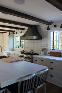 modern farmhouse renovation blog kitchen and light fictures. windows.