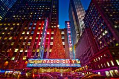 Late evening view in New York City (NYC) on 6th Avenue and 50th Street looking at Radio City Music Hall at Rockefeller Center