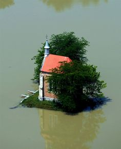 Sandor H. Szabo / Hungarian Police ORFK via AFP - Getty Images Zichy chapel is surrounded by water from the flooded Danube river on June 9, 2013 near the village of Lorev, Hungary.