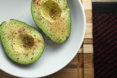 One of my favorite snacks: avocado seasoned with black pepper and pink Himalayan sea salt.