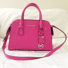 "⚡️SALE⚡️Michael Kors Harper Raspberry Med Satchel Purchased from Dillard's. 100% authentic- proof of purchase sticker on back of the tag. Additional pictures upon request. Please ask all questions before purchasing.   MICHAEL Michael Kors glazed ranch leather satchel bag. Rolled top handles; 4"" drop; logo charm hangs from top. Removable, adjustable shoulder strap. Flap pockets on exterior sides. Dipped zip top. Inside: logo jacquard lining; key leash. One zip and one open pocket. 8.5""H x…"