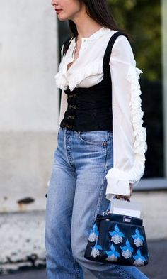 Street style from New York Fashion Week. Your style takeout? Bodice tops are the new spaghetti strap vests: wear them over tees and ruffled shirts Womens Fashion Online, Latest Fashion For Women, Estilo Denim, Vogue, Style Snaps, Cool Street Fashion, Street Style Looks, Mode Style, Fashion Bloggers