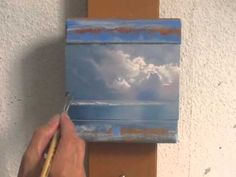 A painting a week. This is good. Small painting of clouds and beach.